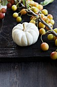 An ornamental pumpkin with ornamental apples