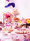 A tea party with cake, cupcakes and sandwiches