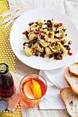 Marinated artichokes, white bread and Campari soda (Italy)