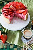 Strawberry mousse cake, sliced, and a cup of coffee