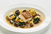 Zander fillet in a smoked mushroom broth with spinach and baby gnocchi