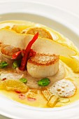 Scallops on bean puree with bean blinis