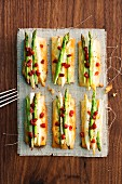Asparagus tapas with chorizo and cheese