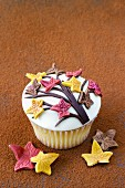 A spiced cupcake decorated with sugar leaves