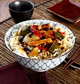 Rice noodles with chicken, vegetables and black bean sauce (Asia)