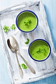 Cream of pea soup garnished with parsley