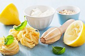 Ingredients for making tagliatelle with feta, lemon and basil