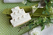 And napkins decorated with a rhinestone, a wedding cake shaped biscuit, spirea, and a matthiola flower