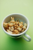 Spiced popcorn in a football cup
