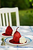 Poached pears with cranberry sauce and cream garden table
