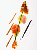 An artistic arrangement of smoked salmon, tamaras, salmon caviar and strips of toast