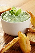 A wild garlic dip with white bread