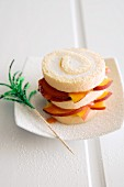 Bellini cake made with Swiss roll slices and peaches