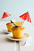 Caipirinha-soaked cakes garnished with limes and cocktail umbrellas