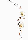 Nuts, seeds and pills in glass dishes and in tweezers