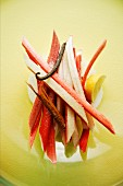 Sliced rhubarb with cinnamon sticks, lemon and a vanilla pod