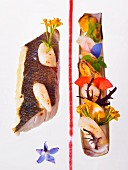 A fish fillet with mussels and edible flowers