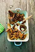 Grilled chicken wings and spare ribs with passion fruit sauce