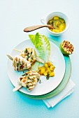 Grilled monk fish medallions speared on sticks of lemongrass with a mango and leek sauce