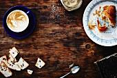 Cappuccino, sugar, a croissant and biscotti