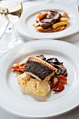 Cod with lobster claws, gratinated potatoes and sliced aubergines