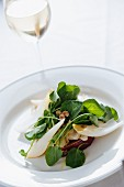 Chicory salad with pears, hazelnuts and watercress