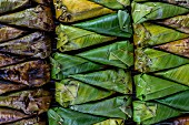 Sticky rice with banana grilled in banana leaves, Thailand