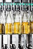 Close up of bottles on a conveyor belt