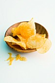 Potato crisps in a wooden bowl