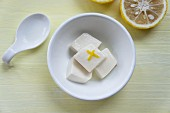 A bowl of tofu with yuzu juice and zest