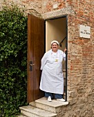 Head chef Valeria Piccini standing at the door of her restaurant Da Caino