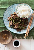 Beef with green beans, Sichuan pepper and rice (China)