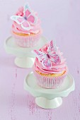 Romantic cupcakes decorated with pink buttercream and butterflies