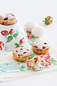 Strawberry muffins dusted with icing sugar