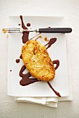 Mango escalope with a coconut coating and chocolate and ginger sauce