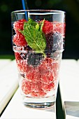 A refreshing drink made with raspberries, blackberries and mint