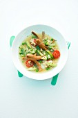 Alphabet soup with vegetables and sausages