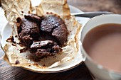 Chocolate cake with a liquid centre served with a cup of tea
