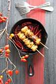 Fried chicken skewers with chilli peppers