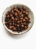 Whole Cloves in a Jar and On a Dish