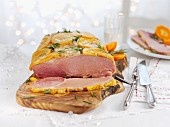 Glazed roast ham with oranges and rosemary