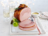 Glazed ham with dried apricots, sliced, for Christmas