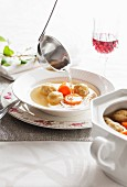 Kosher chicken soup with dumplings