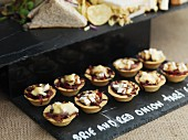 Brie and red onion tartlets