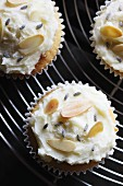 Cupcakes decorated with slivered almonds and dried lavender flowers