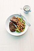 Beef steaks with a chickpea salad (seen from above)