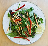 Mixed leaf salad with vegetable strips and a mustard dressing
