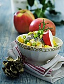 Herring salad with apple, egg and spring onions