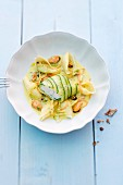 Monk fish fillet wrapped in courgette on a bed of mussels and shell pasta