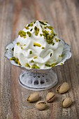 Frozen yogurt with chopped pistachios